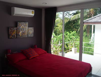 red bedroom with double bed 1.50 m wide shower his Italian villa has large terrace in Koh Samui Suratthani Thailand