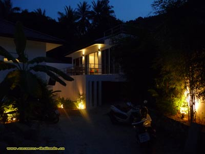 prices for homes with pool and terrace walls stonework lit at night in the spring Koh Samui Thailand